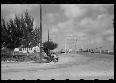 From LOC: Highway intersection near Belle Glade, Florida. Negro bean pickers hitchhiking